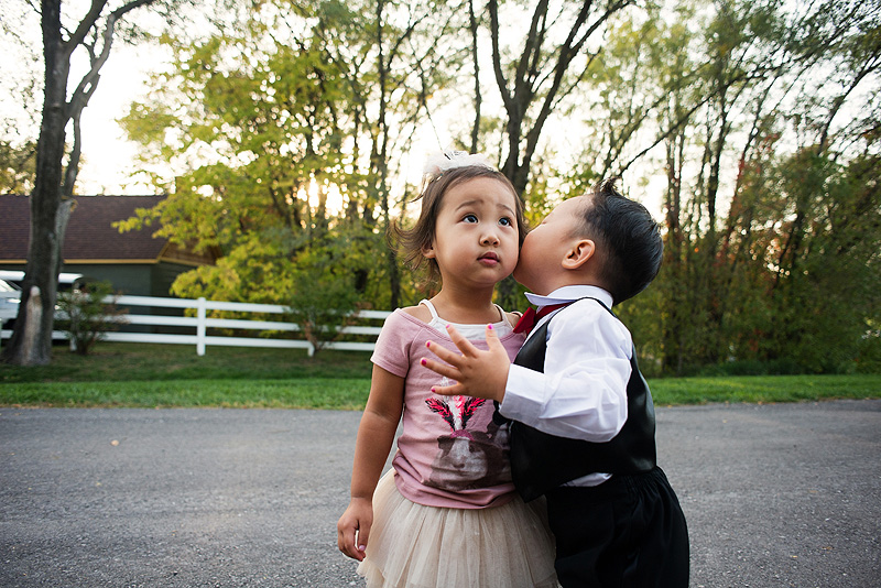 Little boy kissing a girl.