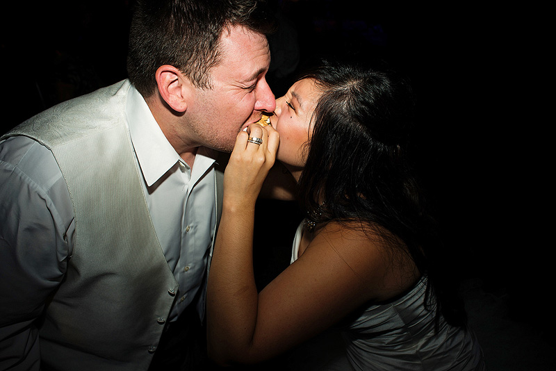 Bride and groom sharing s'mores at their Kansas City wedding reception.