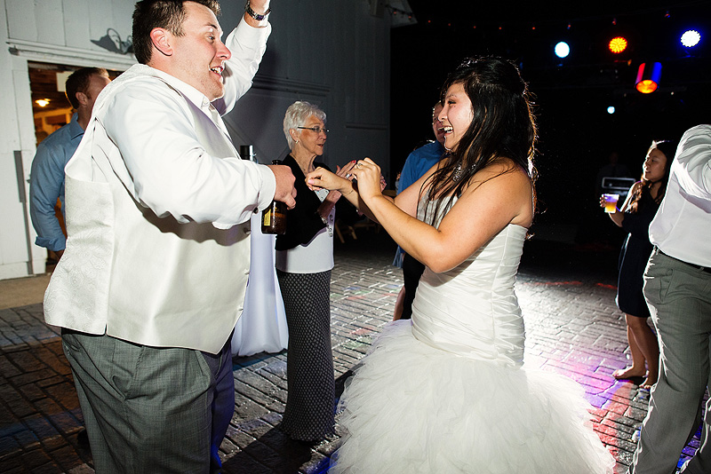 Bride and groom dancing at their Fresh Air Farms wedding reception in Kansas City.