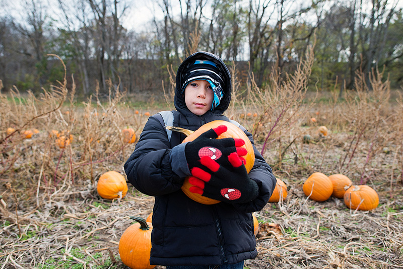 Boy with his pumpkin at Powell's Pumpkin Patch in Kansas.