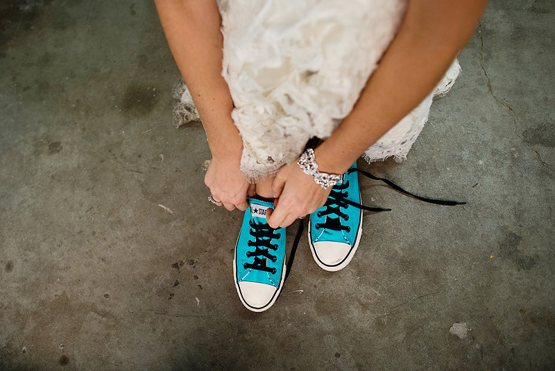 Bride wearing blue converse on her wedding day.