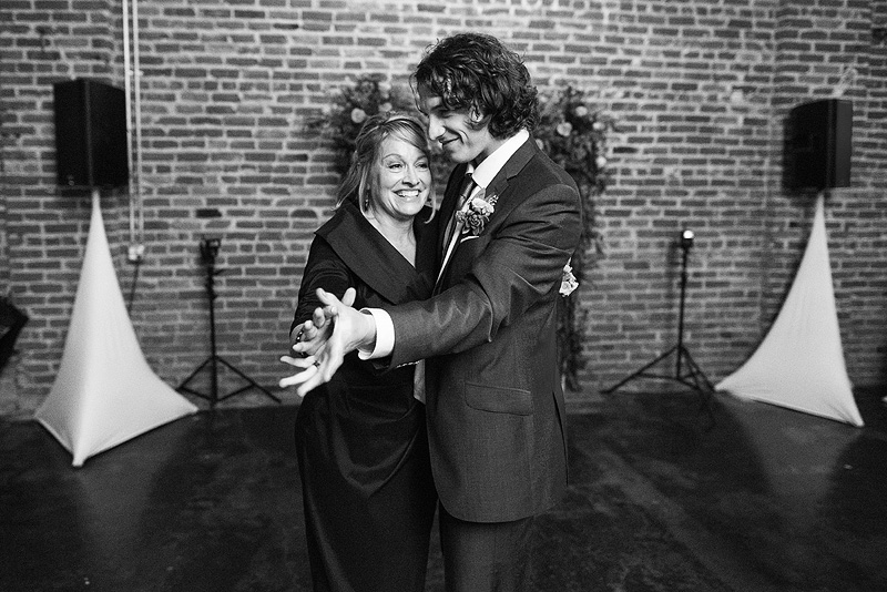 Groom dances with his mom.