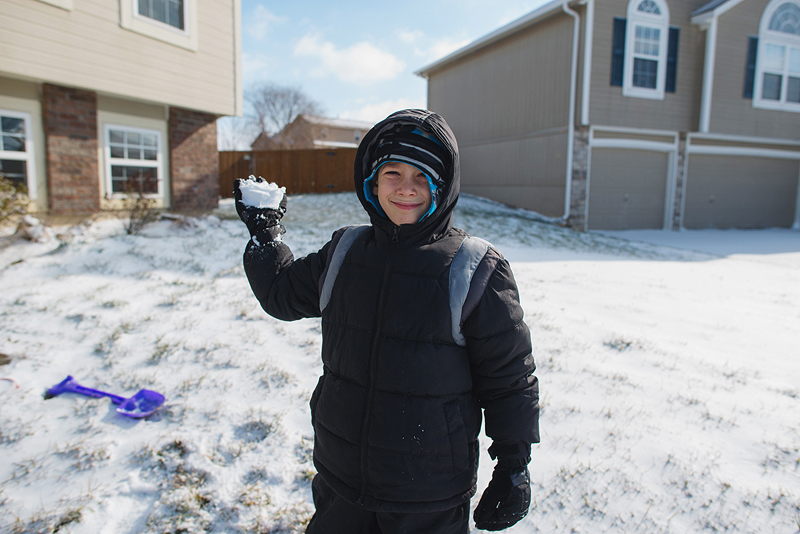 Boy ready to throw snowball.