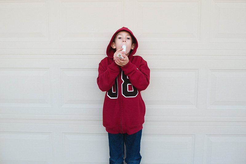 Boy with a marshmallow shooter.