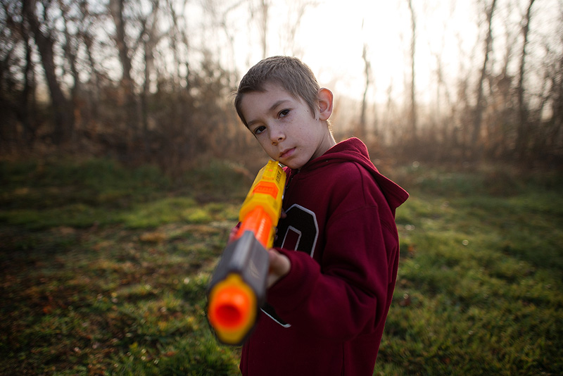 Boy with a Nerf gun zombie hunting.