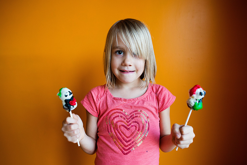Girl with her Snowman Cake Pops.
