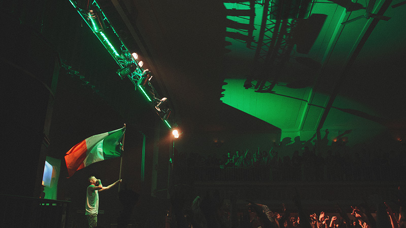 Macklemore holding an Irish flag at his concert in Omaha Nebraska.