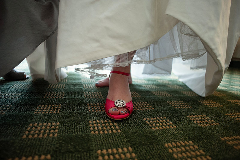 Awesome bright pink wedding shoes.