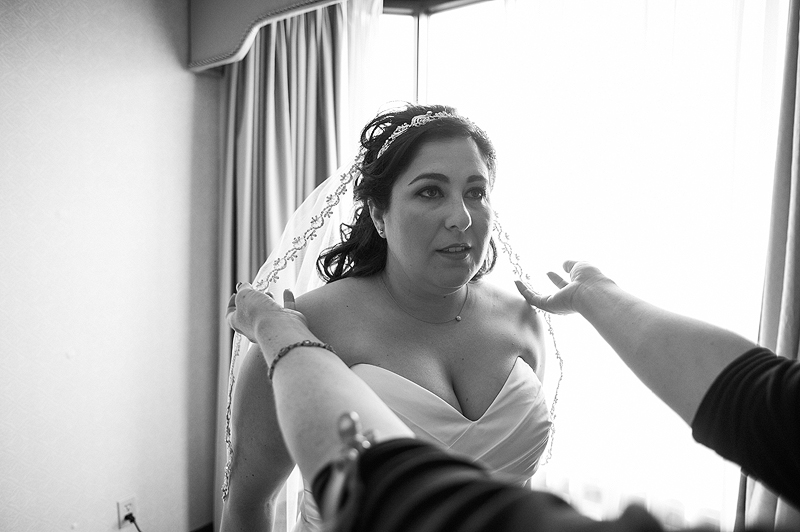 Bride getting ready for her wedding in Kansas City.