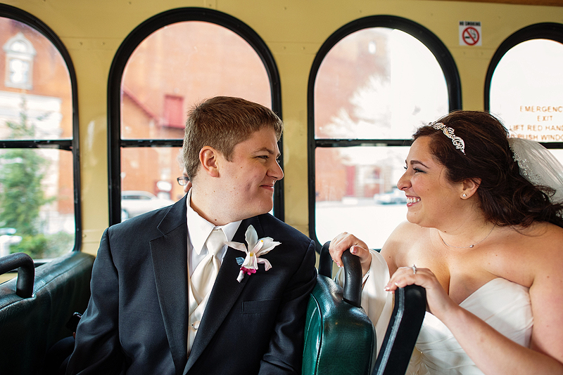 Cute bride and groom picture on a trolley in Kansas City.