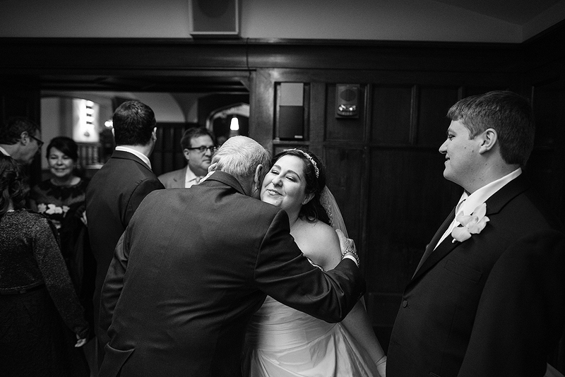 Bride hugging her grandpa at the Clubhouse on Baltimore.