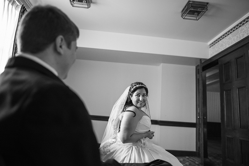 Beautiful bride looking at her groom with love.
