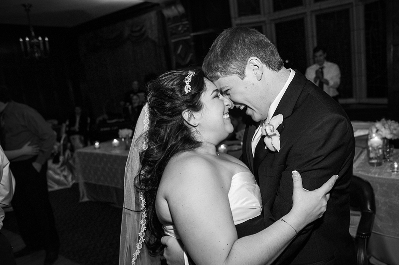 Happy bride and groom dancing at their wedding reception.