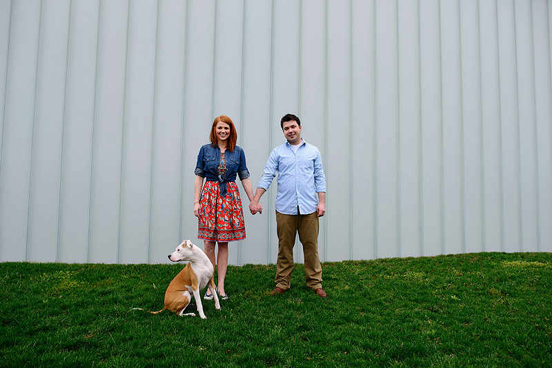 Happy couple with their pit bull.