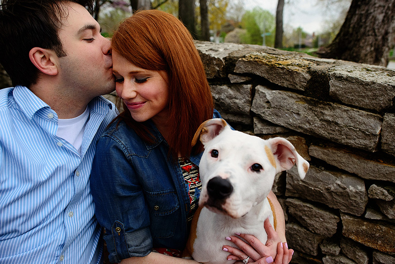 Fun engagement picture with their pit bull.