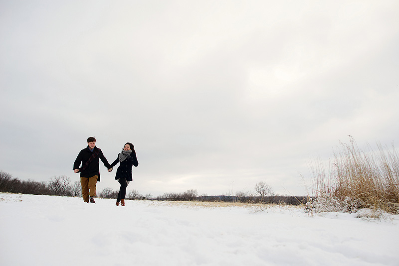 Couple in love running through the snow.