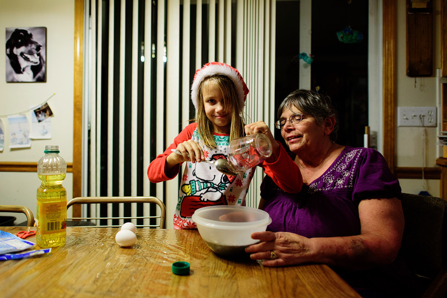 girl baking cookies with grandma