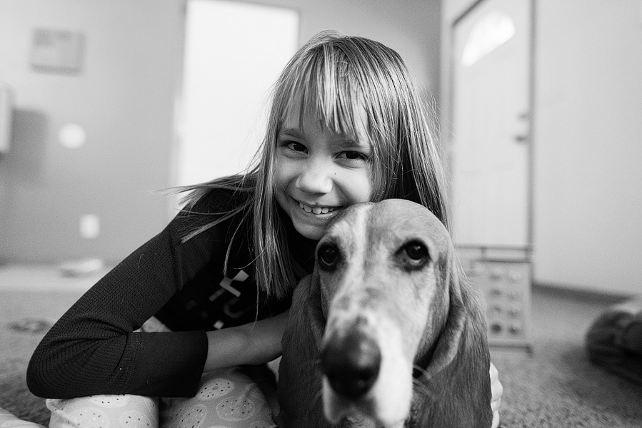 girl and her basset hound