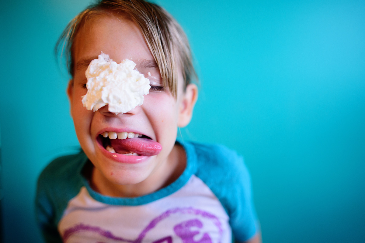 Girl having fun with the Pie Face game.
