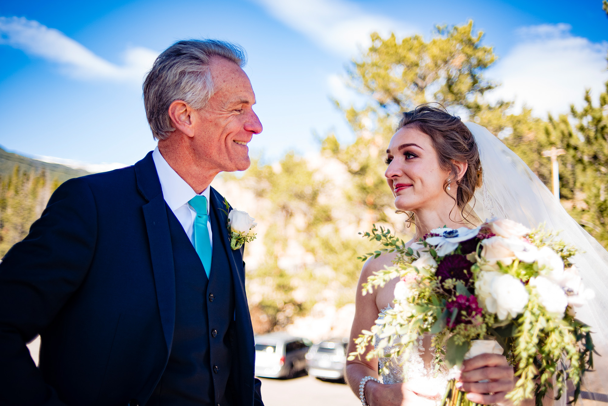 father and daughter before her wedding ceremony in estes park, colorado